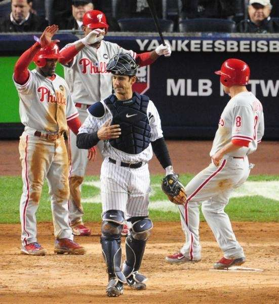 New York Yankees' Jorge Posada grimaces as Phillies'