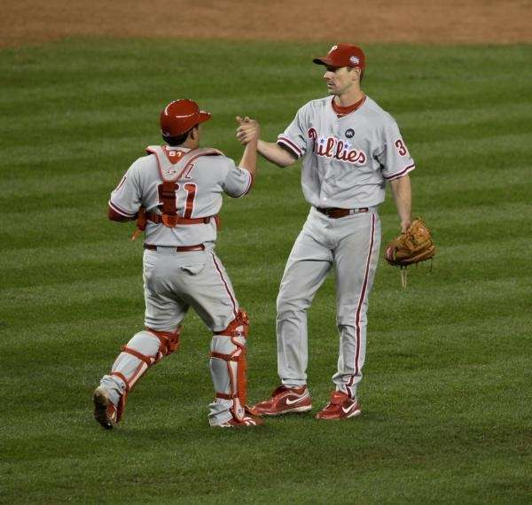 Carlos Ruiz and Cliff Lee celebrate after winning