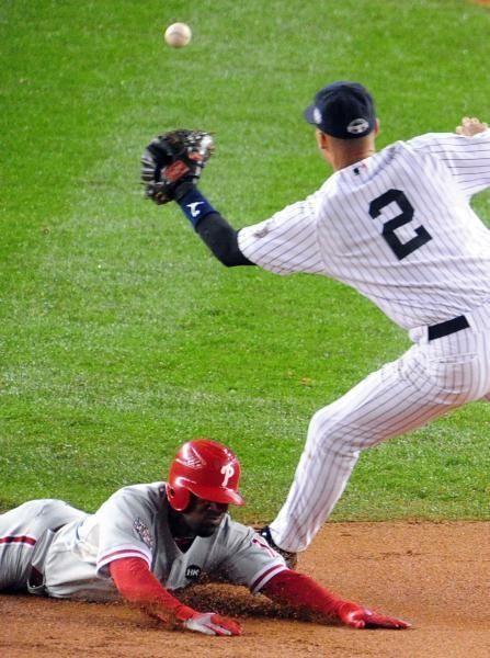Philadelphia's Jimmy Rollins steals second base past New