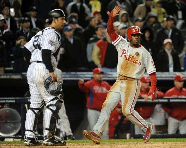 Philadelphia Phillies' Jimmy Rollins (11) scores on a