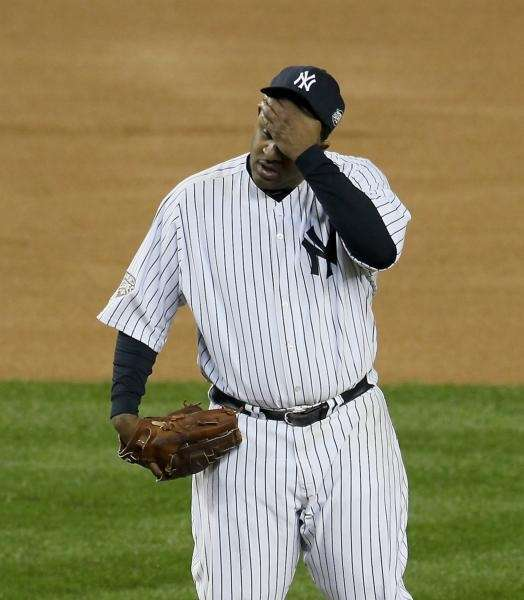 CC Sabathia wipes his brow in the 7th