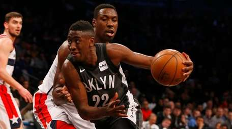 The Nets' Caris LeVert drives against the Wizards'