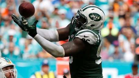 Jets defensive end Muhammad Wilkerson intercepts a pass