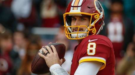 Redskins quarterback Kirk Cousins warms up before a