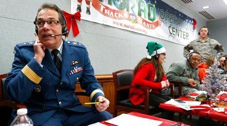 Canadian Brig. Gen. Guy Hamel answers phones inside