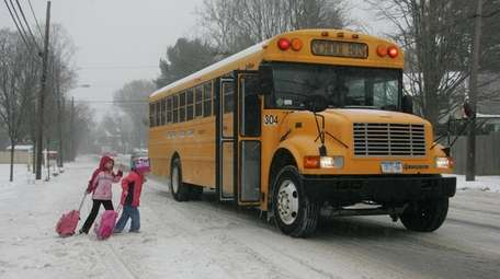 Two students in the Huntington school district trudge
