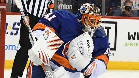 Islanders goalie Jaroslav Halak makes a save during