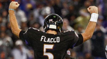 Ravens quarterback Joe Flacco completes a touchdown pass