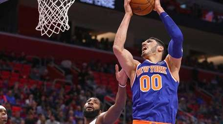 The Knicks' Enes Kanter grabs a rebound next