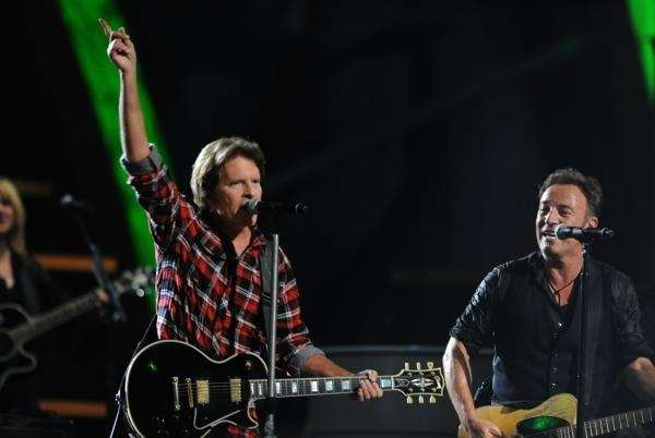 John Fogerty and Bruce Springsteen perform onstage at