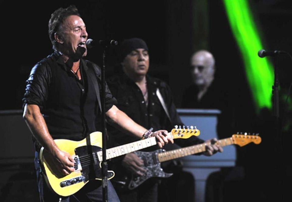 Bruce Springsteen, left, and Steven Van Zandt perform
