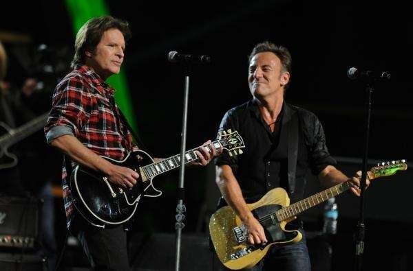 John Fogerty and Bruce Springsteen onstage at the