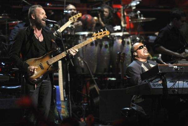 Stevie Wonder, right, and Sting perform during the