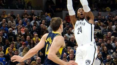 Nets forward Rondae Hollis-Jefferson shoots over Pacers forward
