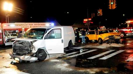 A van and a taxi cab collided at