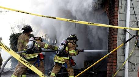 Firefighters battle the blaze in Oakdale on Sunday,