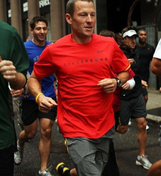 Runners and fans jog with Lance Armstrong in