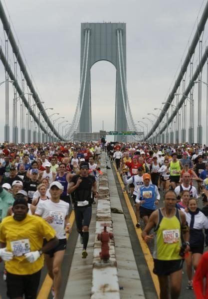 Runners cross the Verrazano Narrows Bridge at the