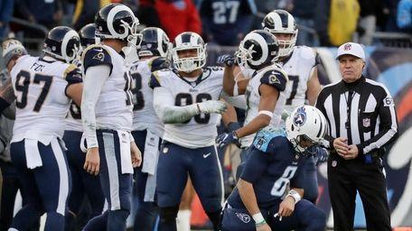 Titans quarterback Marcus Mariota (8) gets up off