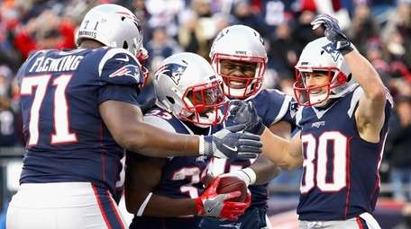 Dion Lewis of the Patriots reacts with teammates