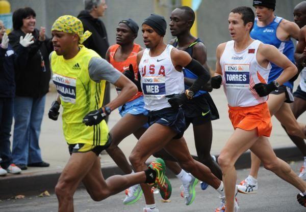 US marathon runner Meb Keflizghi, center, runs with