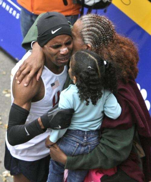 First place finsher Meb Keflezighi hugs his mother,