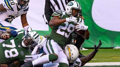 Jets running back Bilal Powell crosses the goal