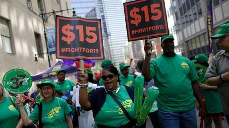 Activists cheer after the New York Wage Board