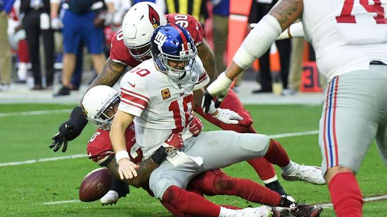Quarterback Eli Manning of the Giants is sacked