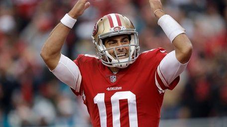 49ers quarterback Jimmy Garoppolo celebrates during the second