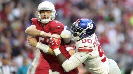 Quarterback Drew Stanton of the Cardinals is hit