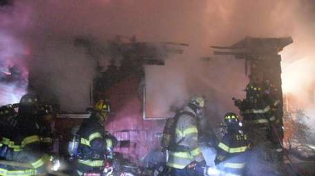 The Central Islip Fire Department battles blaze at
