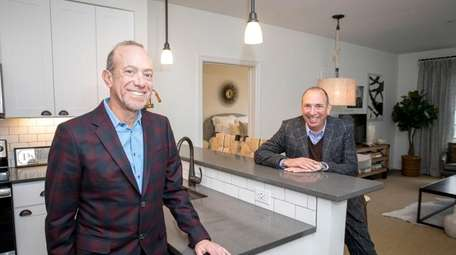 Mitchell and Gregg Rechler in a model apartment