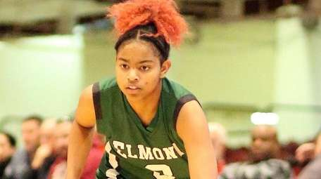 Elmont's Zarria Franklin works to get a shot