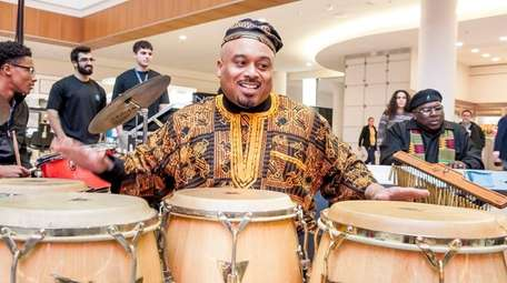 Raleigh Hall plays at a Kwanzaa event at