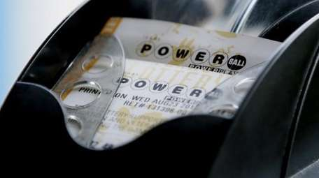 A Powerball lottery ticket is printed in Dallas,