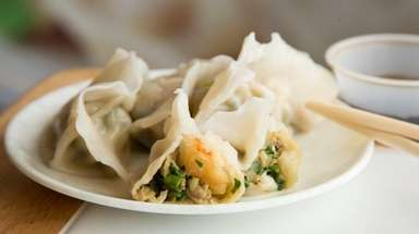 Delicate seafood dumplings are stuffed with shrimp, pork