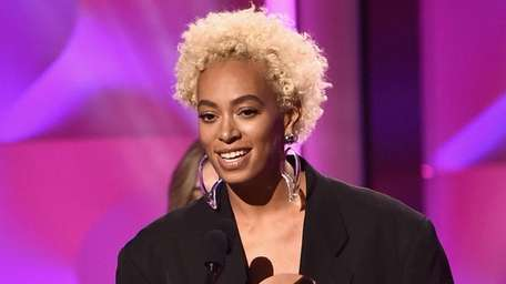 Solange accepts an award at the Billboard Women