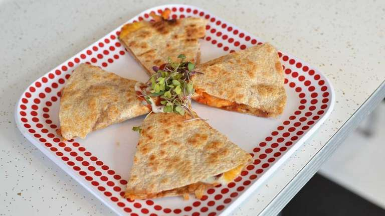 A barbecue chicken quesadilla is served at Crazy