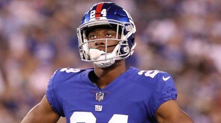 Giants cornerback Eli Apple waits for play to
