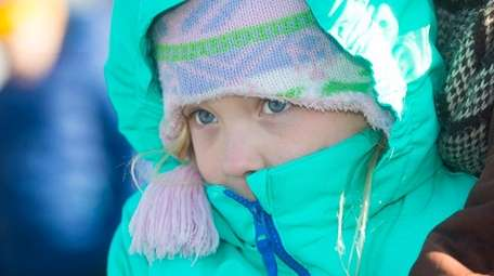 LeNeve Zuhoski, 8, of Southold is bundled up