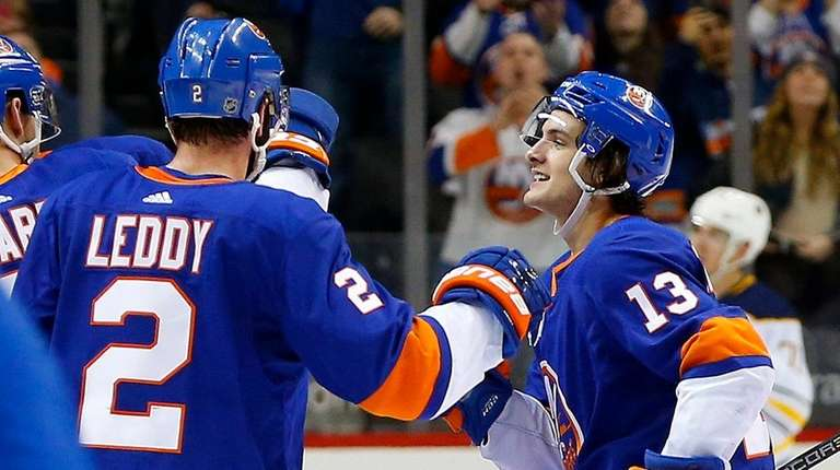 The Islanders' Mathew Barzal celebrates his overtime goal