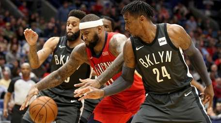 The Pelicans' DeMarcus Cousins fights for a rebound