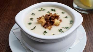 A creamy parsnip and pear soup topped with