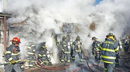 Brentwood firefigthers battle a blaze at Fifth Avenue