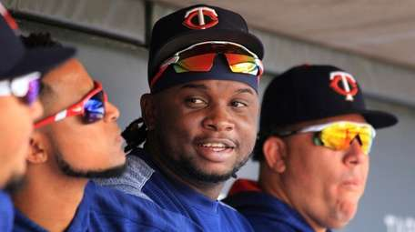 Twins third baseman Miguel Sano sits in the