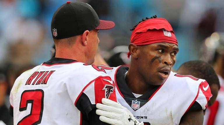 Falcons wide receiver Julio Jones gives quarterback Matt