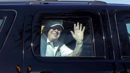 President Donald Trump waves to supporters as he