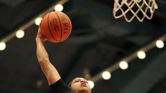 Half Hollow Hills East's Kendall Nero-Clark dunks the