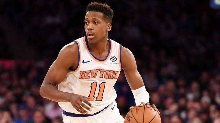 Knicks guard Frank Ntilikina dribbles the ball during
